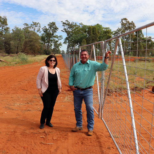Balonne Shire Mayor Samantha O'Toole with Rick Cuffe and the newly completed wild dog exclusion fence.